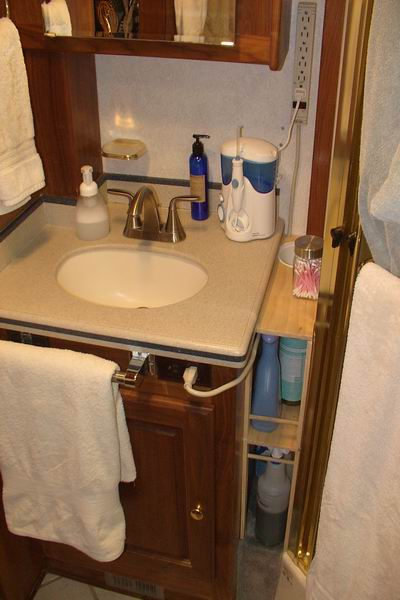 Rv storage food pass thru bins and tots hidden behind drawers Storage solutions for tiny bathrooms
